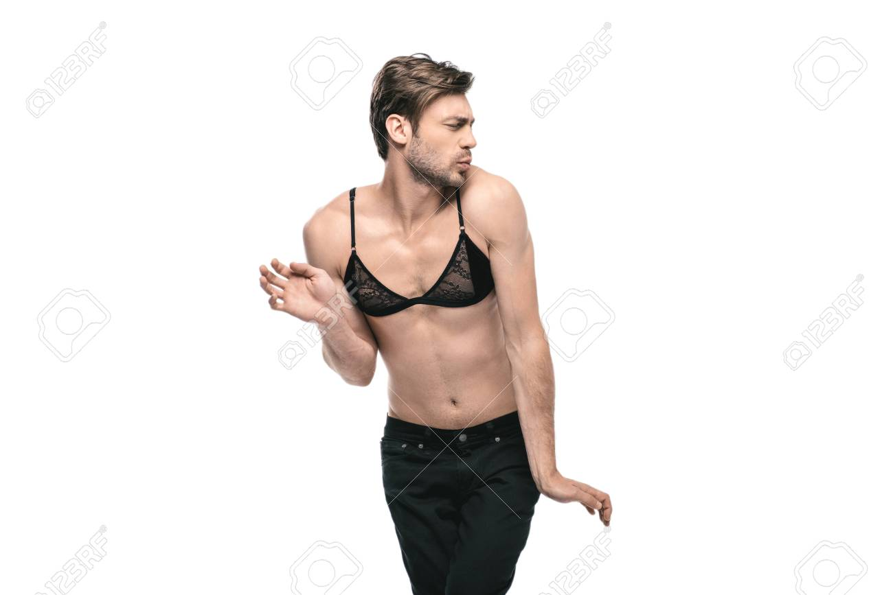 9b2857a8329e2 Stock Photo - young handsome homosexual man wearing womens bra