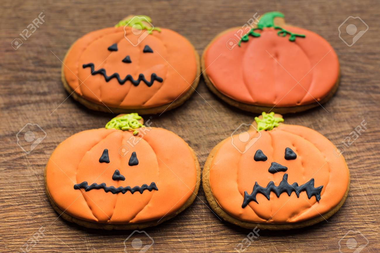 composition of halloween pumpkin cookies on wooden board Stock Photo -  85357193 8b378a5f4ec4