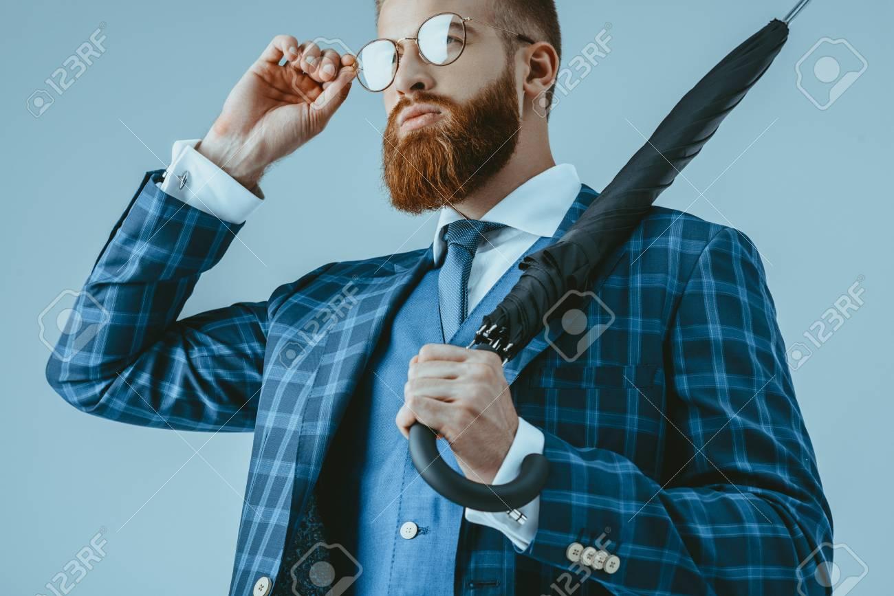 attractive man in suit with umbrella - 86378667