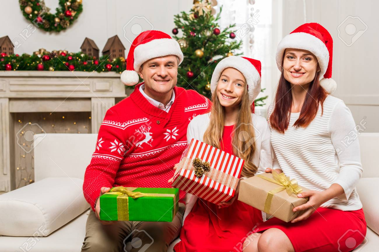 Cute Family With Christmas Gifts In Beautiful Decorated Room Stock ...