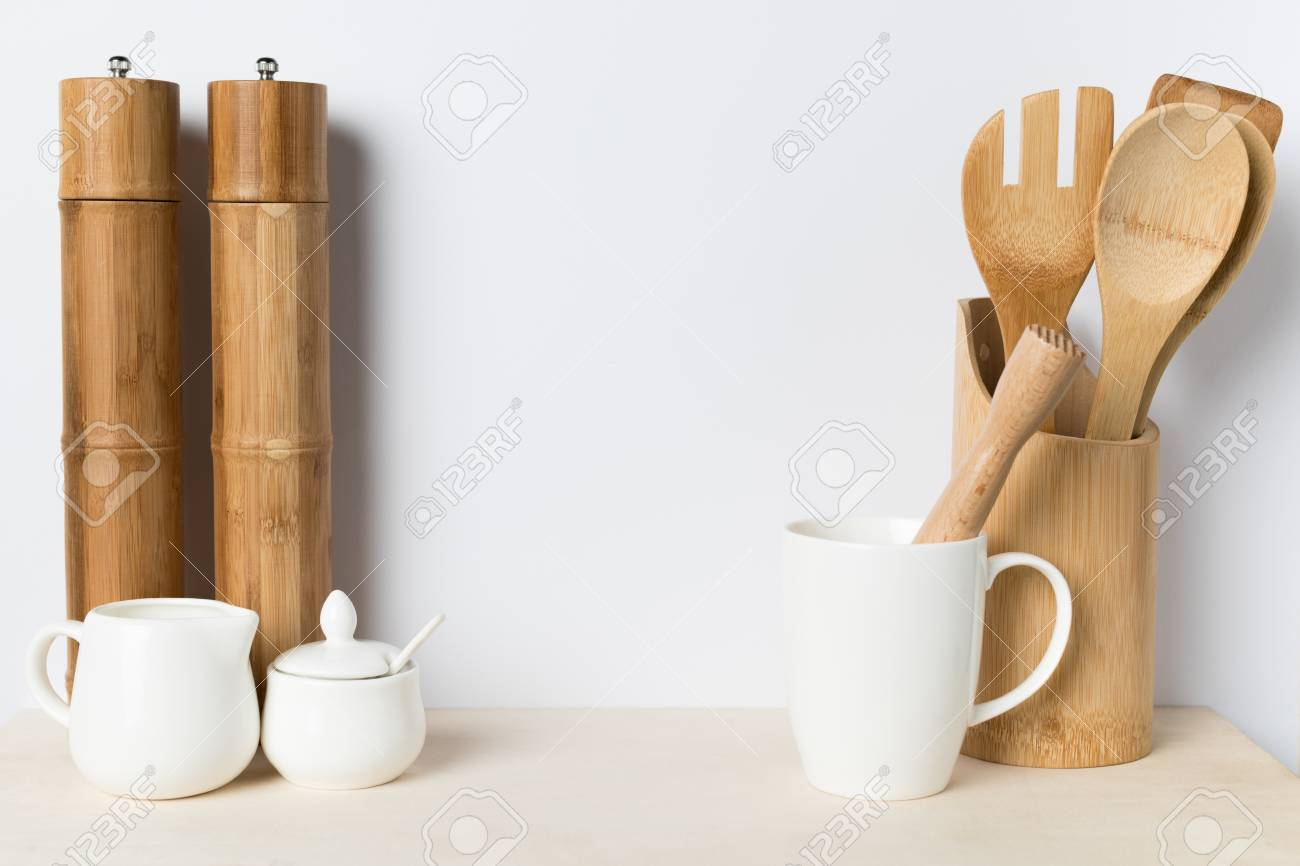 close-up view of wooden, ceramic and bamboo kitchen utensils