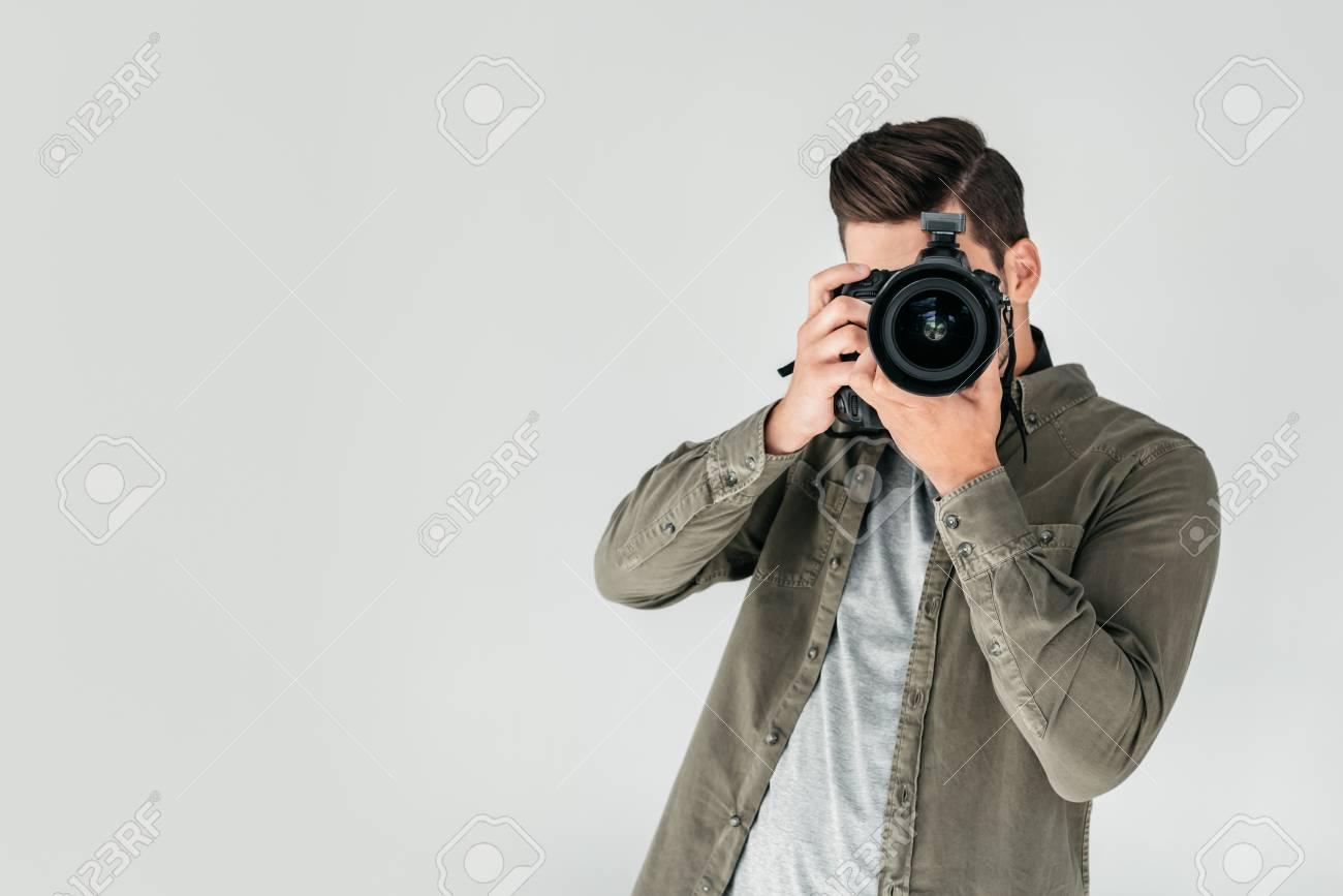 photographer with digital photo camera - 89772381
