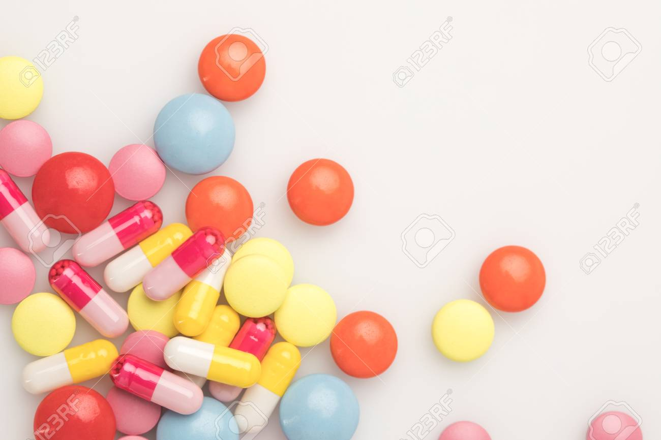 top view of scattered pile of colored pills isolated on white - 89883309
