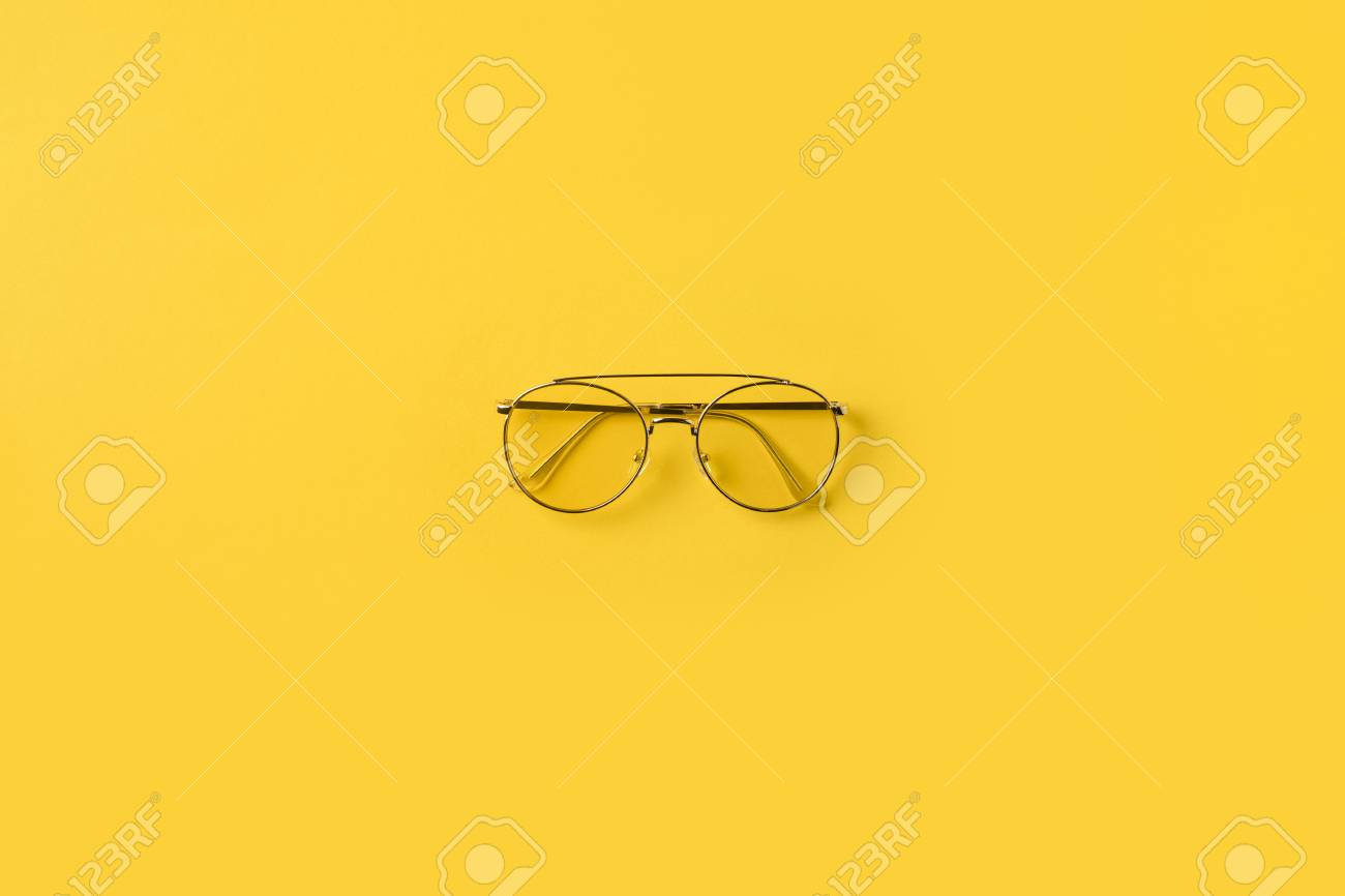 961ae44e961 Top View Of One Stylish Glasses Isolated On Yellow Stock Photo ...
