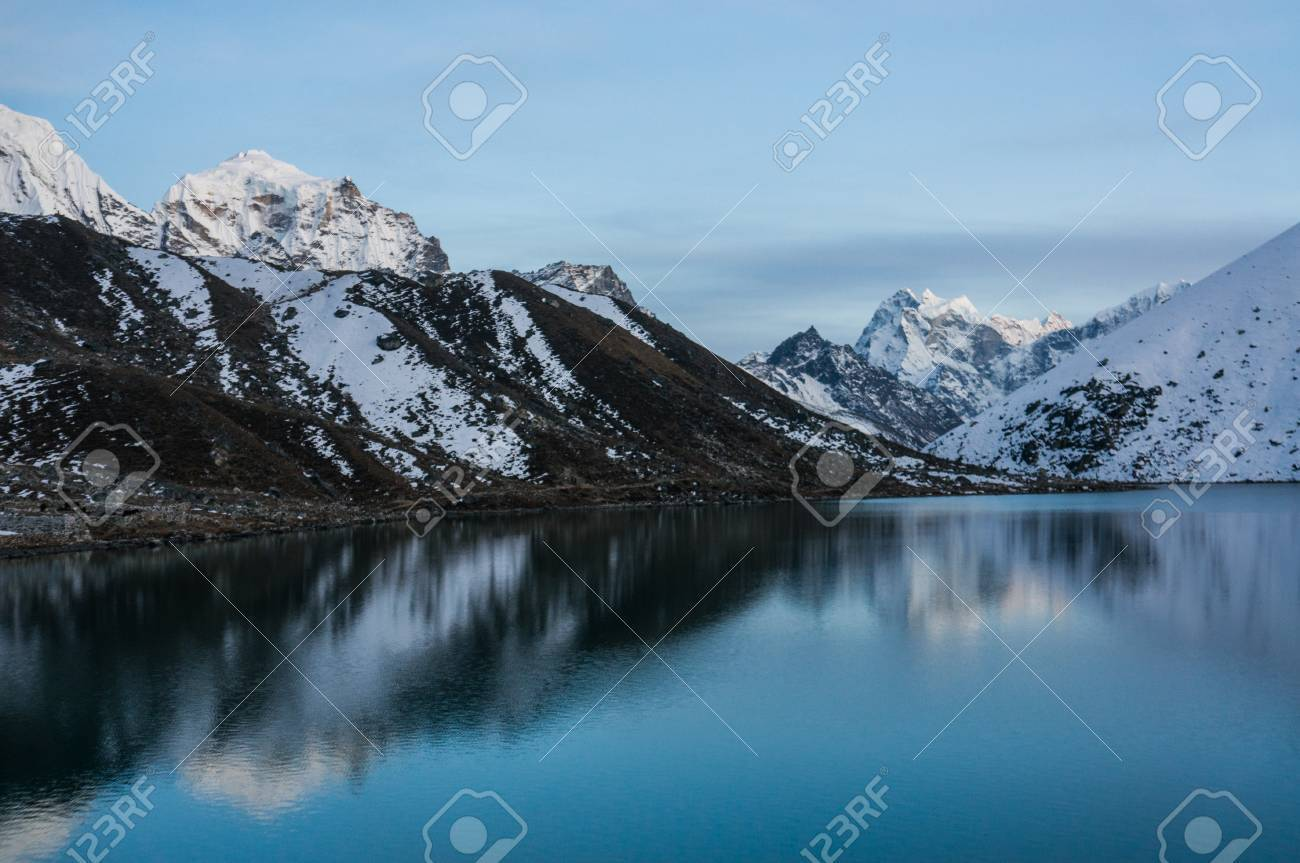 Beautiful Scenic Landscape With Snowy Mountains And Lake Stock Photo