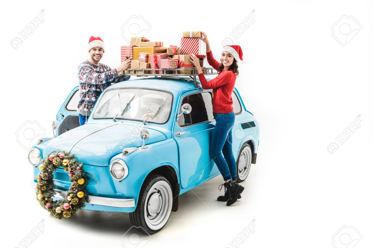 Couple With Christmas Gifts On Car Roof Stock Photo, Picture And ...