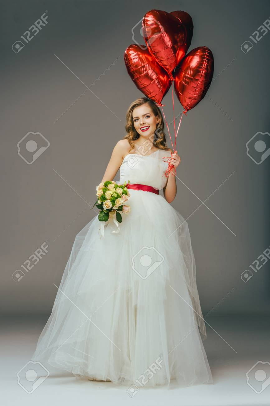 Bride In Wedding Dress With Heart Shaped Balloons And Bouquet ...