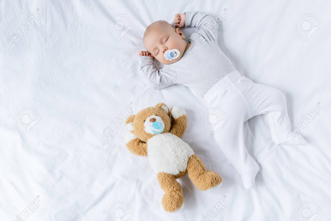 sleeping baby with toy - 95685461