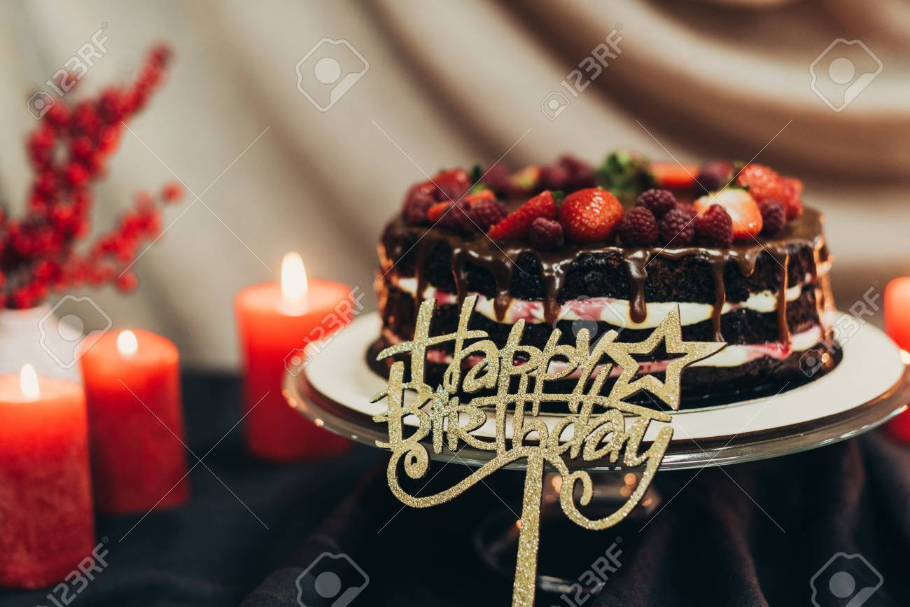 Happy Birthday Cake With Candles On A Table Stock Photo