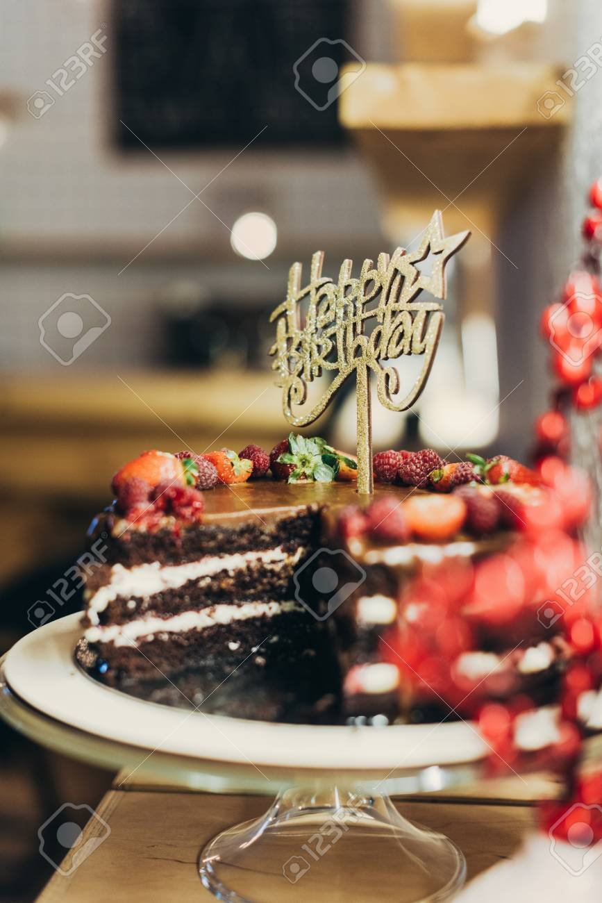 Awe Inspiring Chocolate Cake With Happy Birthday Sign On Cake Stand Stock Photo Personalised Birthday Cards Veneteletsinfo