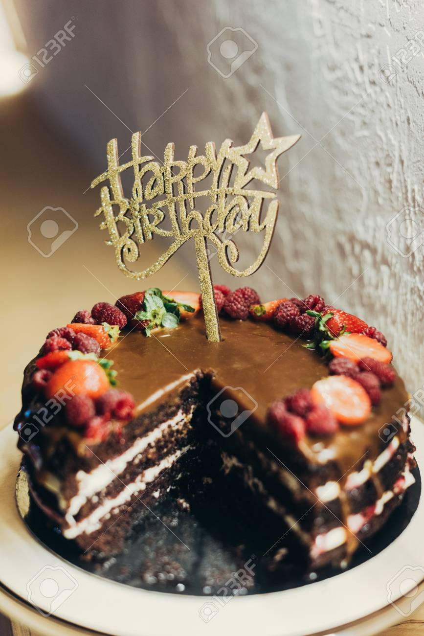Cake With Happy Birthday Sign On Stand Stock Photo
