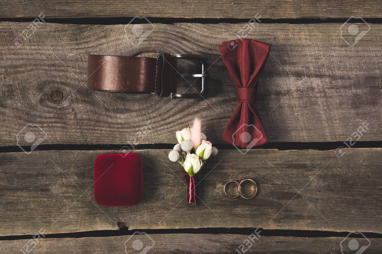 Flat lay with arranged grooms accessories and wedding rings on flat lay with arranged grooms accessories and wedding rings on wooden tabletop stock photo 99843391 junglespirit Image collections