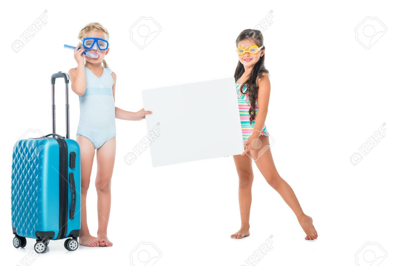 8964722aafcf cute little girls in swimsuits holding blank banner while standing with  suitcase isolated on white Stock