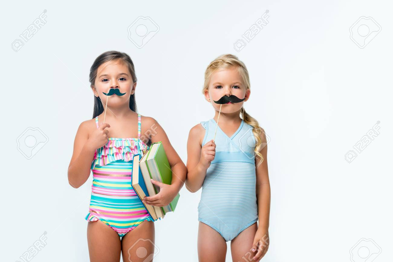 38bb617de5a32 cute little girls in swimsuits holding books and party sticks isolated on  white Stock Photo -