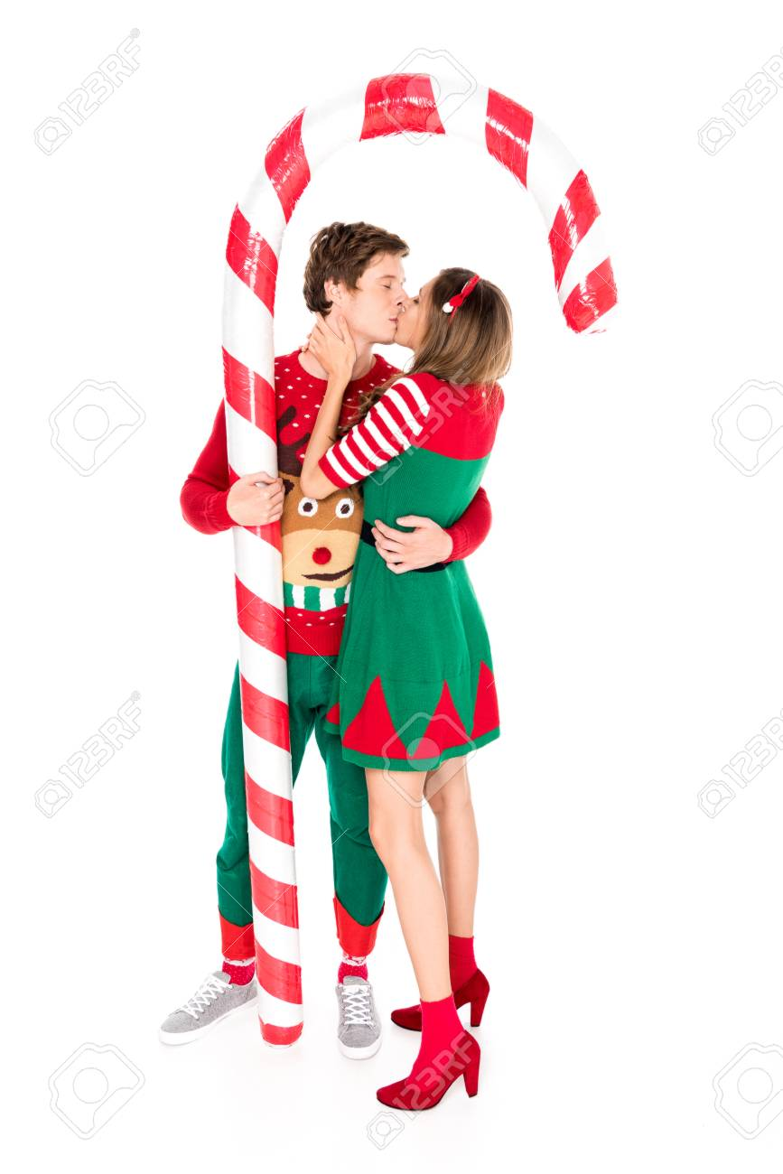 couple in christmas costumes with decorative lollipop kissing each other isolated on white Stock Photo -  sc 1 st  123RF.com & Couple In Christmas Costumes With Decorative Lollipop Kissing ...