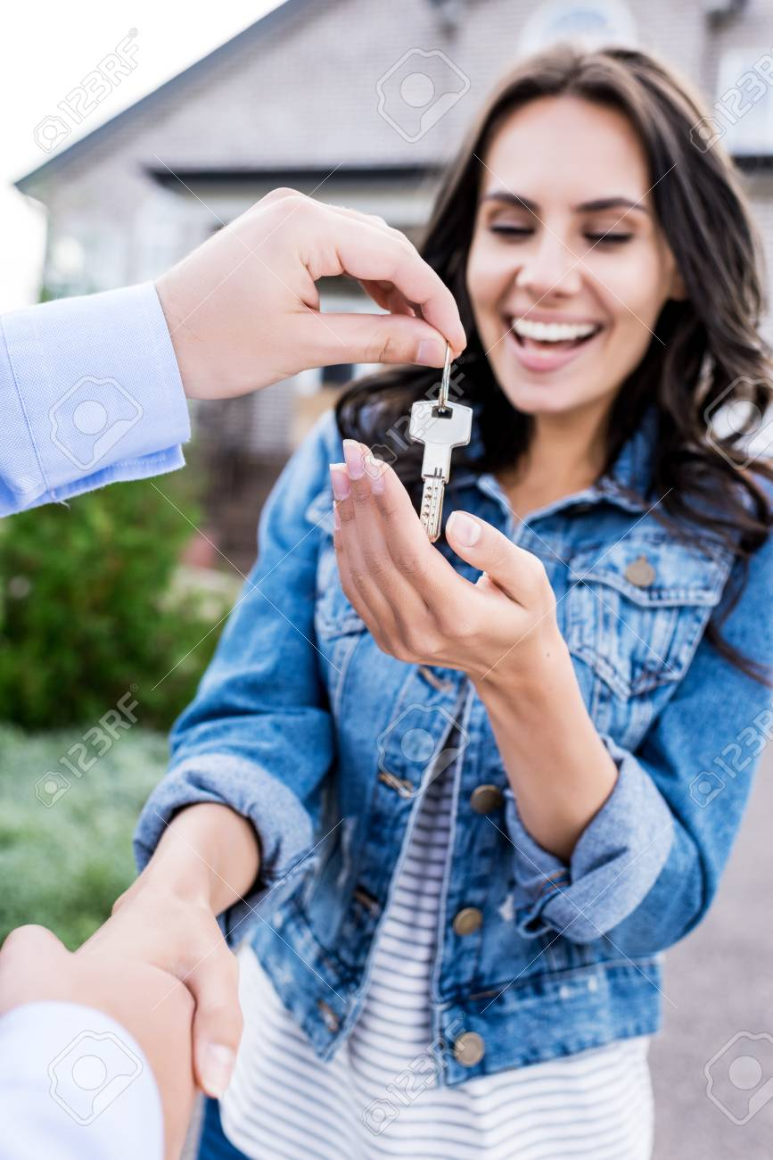 close-up shot of woman buying new house and shaking hands with realtor - 102352118