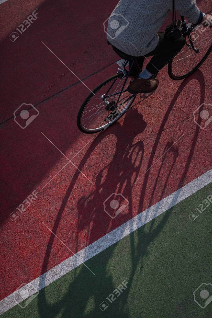 high angle view of man riding bicycle on freshly painted biking