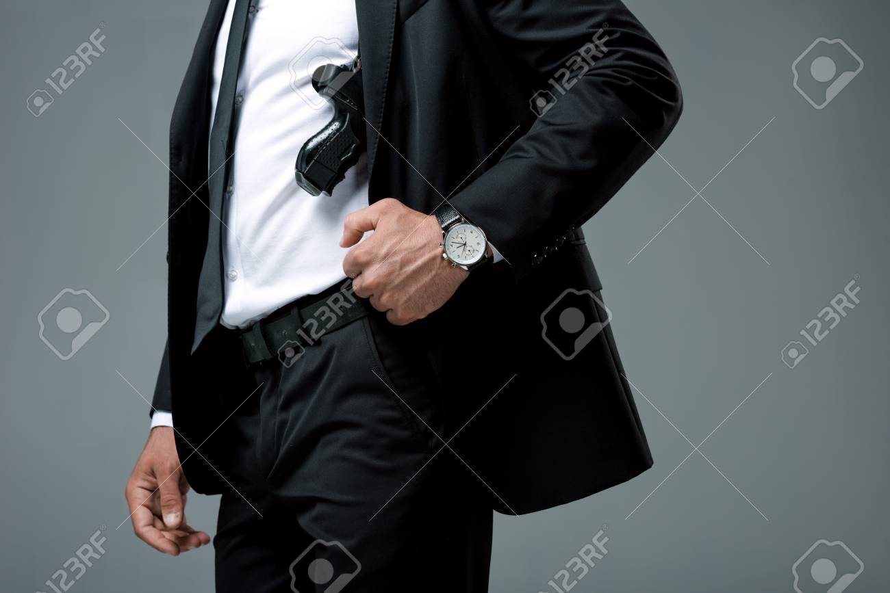 cropped image of security guard standing with gun isolated on grey - 106149741