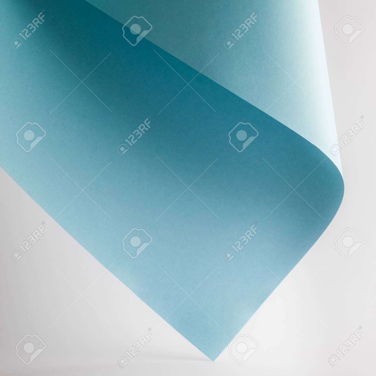 colored blue paper sheet on grey background - 106603339