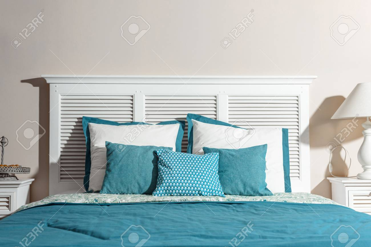 Interior Of Modern Bedroom With White Wooden Bed And Blue Bedsheets Stock Photo Picture And Royalty Free Image Image 106836908