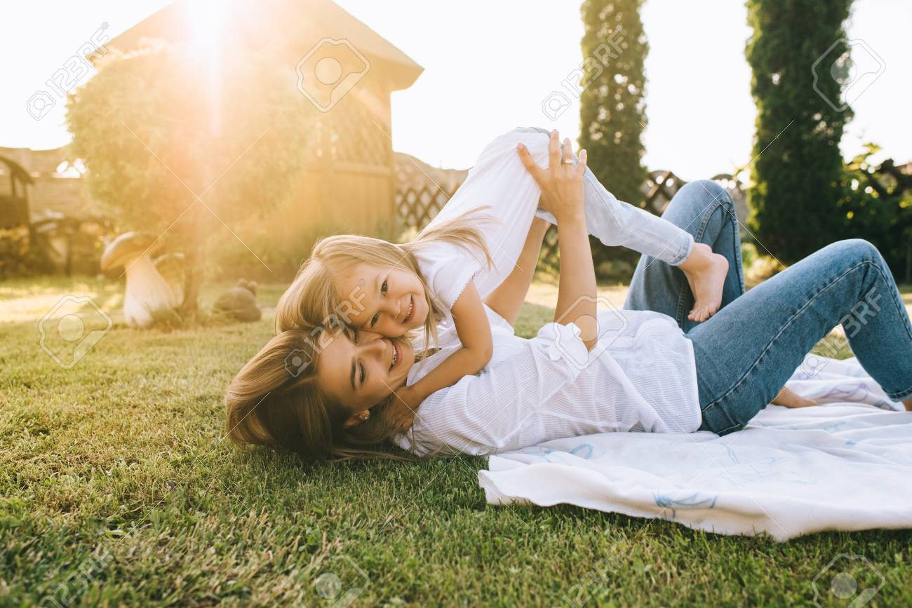 mother and cute little daughter having fun together on backyard - 109146226