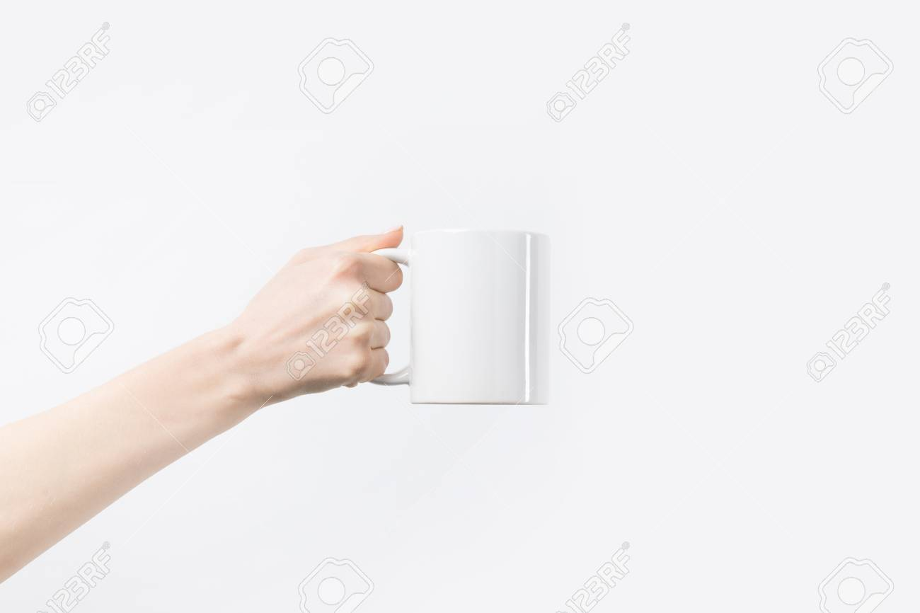 cropped shot of woman holding white mug in hand isolated on white - 109552788