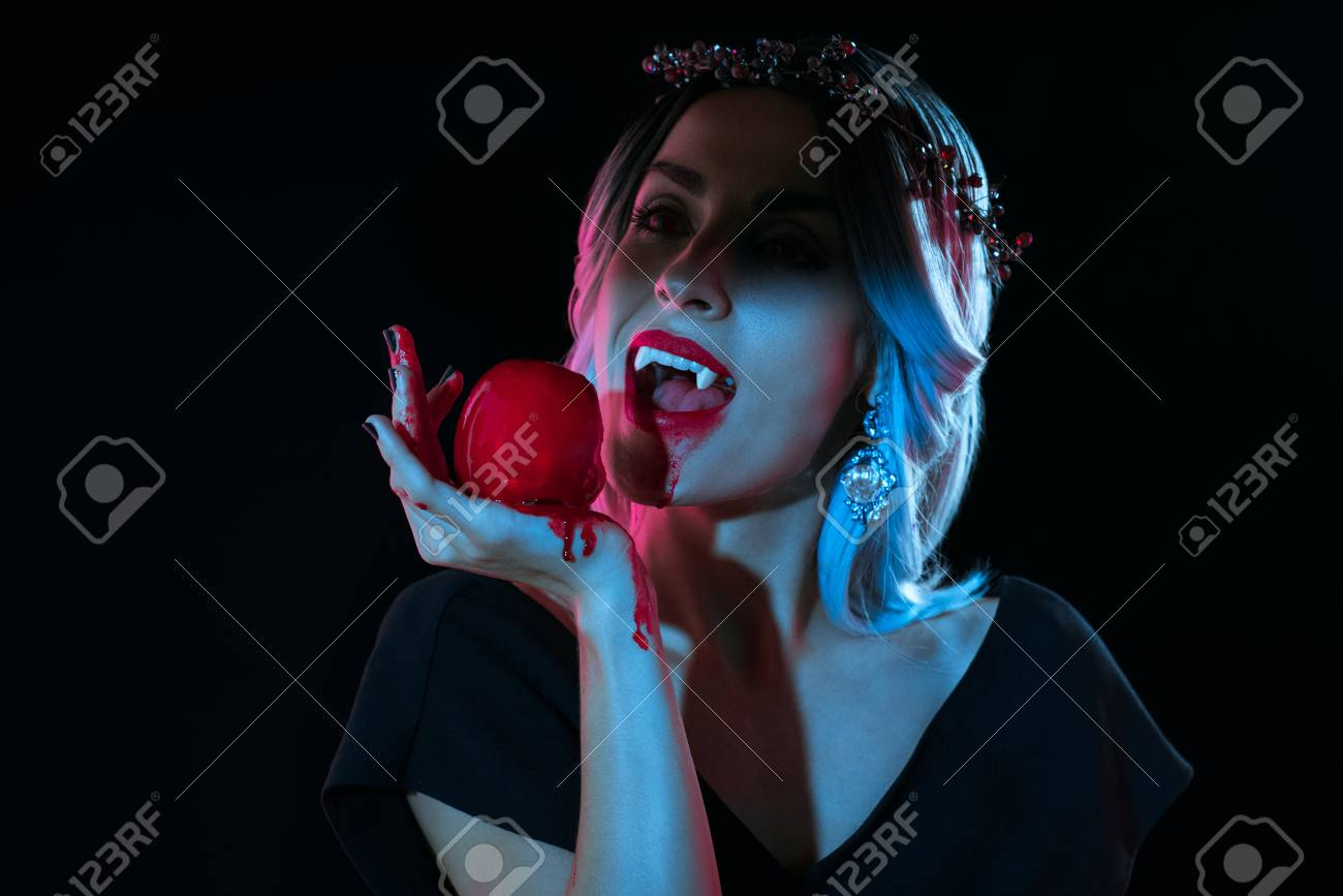 Attractive Vampire Woman Bitting Red Bloody Apple Isolated On Stock Photo Picture And Royalty Free Image Image 110164894