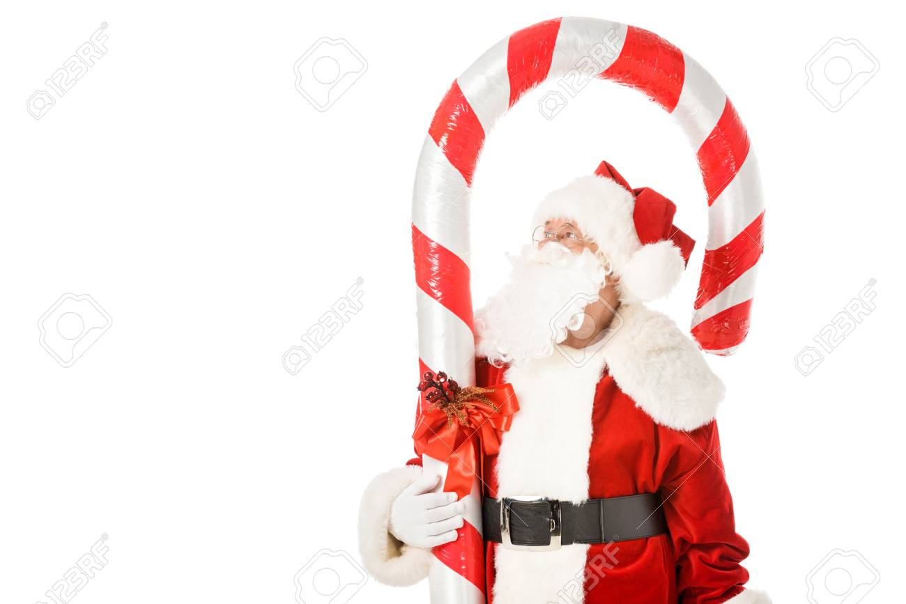 Santa Claus With Giant Candy Cane Looking Up Isolated On White