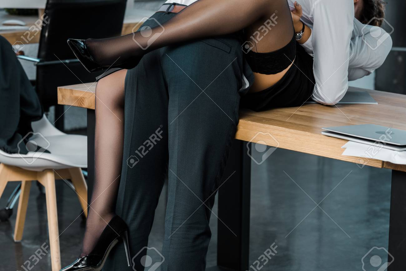 cropped shot of passionate businesswoman and businessman at workplace in office - 111171802