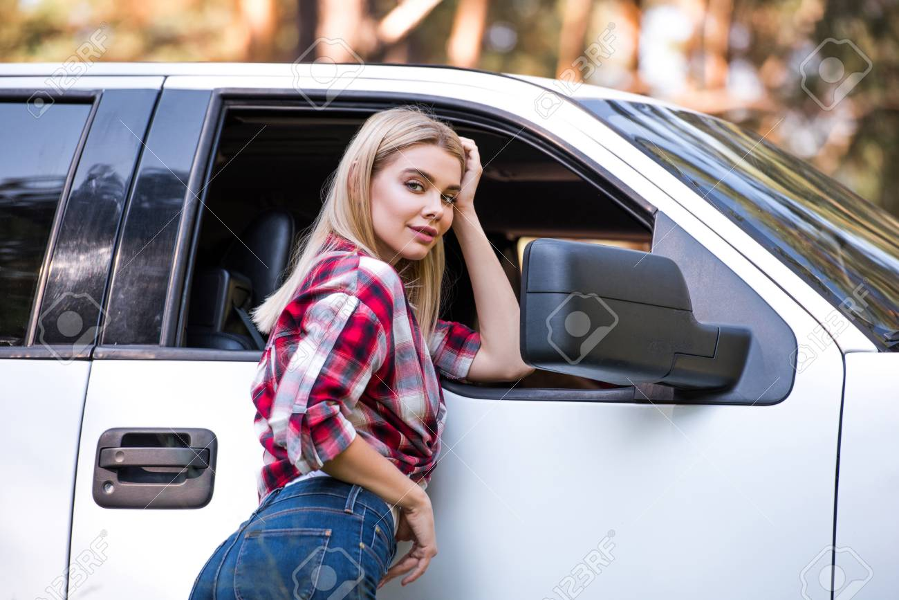 Attractive Blonde Young Woman Standing Near White Pickup Truck Stock Photo,  Picture And Royalty Free Image. Image 110282016.