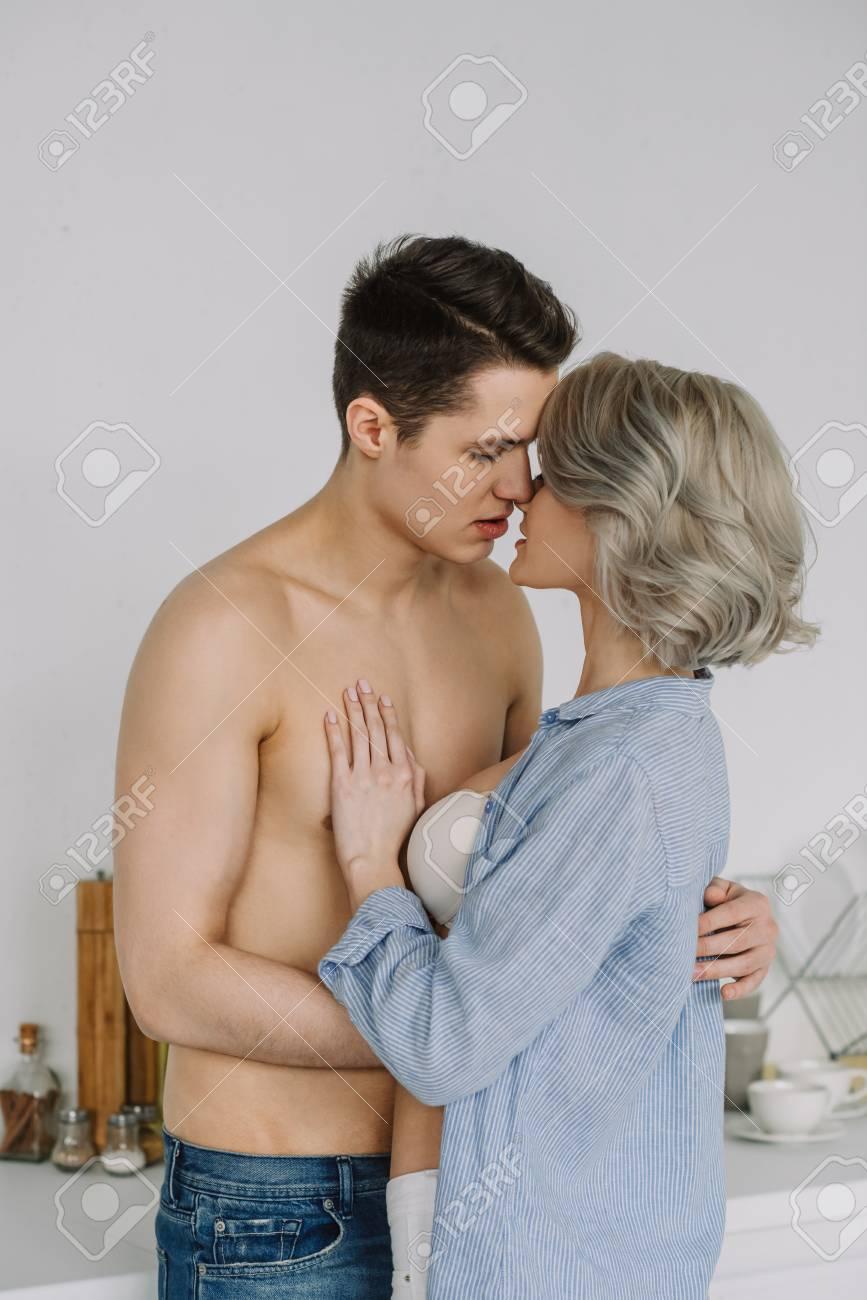 Seductive Half Naked Couple Kissing At Kitchen Stock Photo