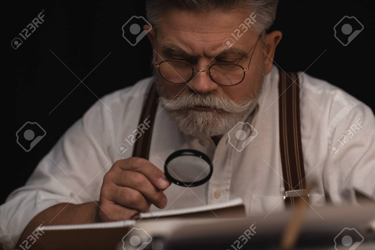 Close-up Portrait Of Senior Writer Reading Manuscript In Notebook.. Stock  Photo, Picture And Royalty Free Image. Image 112011782.