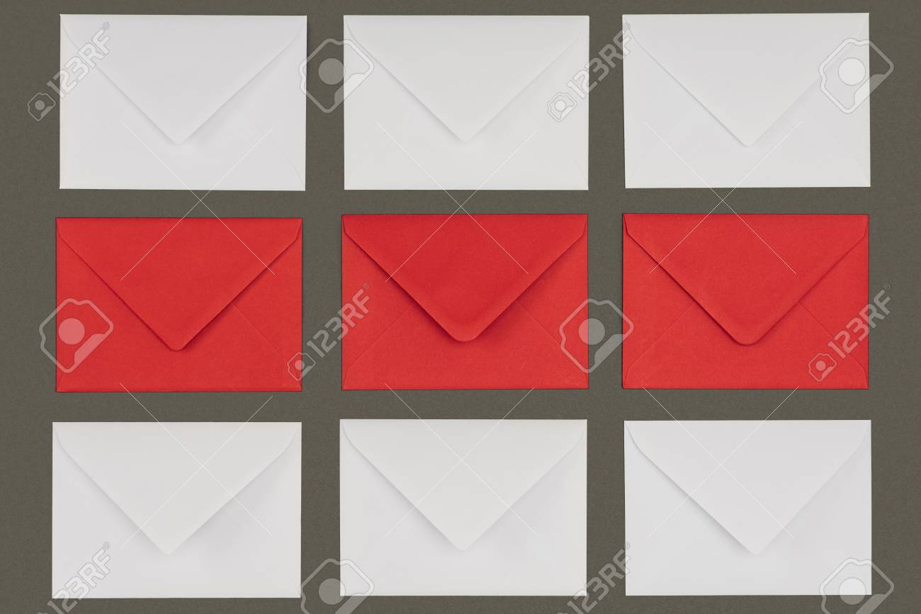 top view of closed red and white envelopes isolated on grey background - 112269398