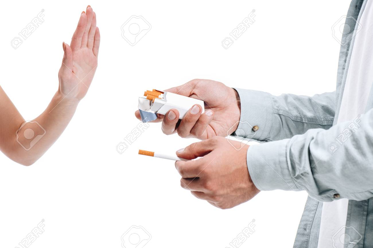 cropped image woman rejecting pack of cigarettes from man isolated on white - 112269584