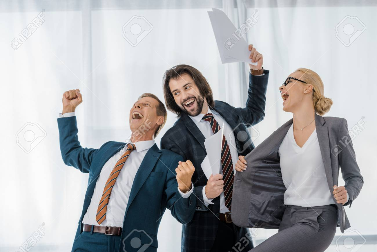 Happy Office Workers Rejoicing Great Deal In Office Stock Photo Picture And Royalty Free Image Image 111826608
