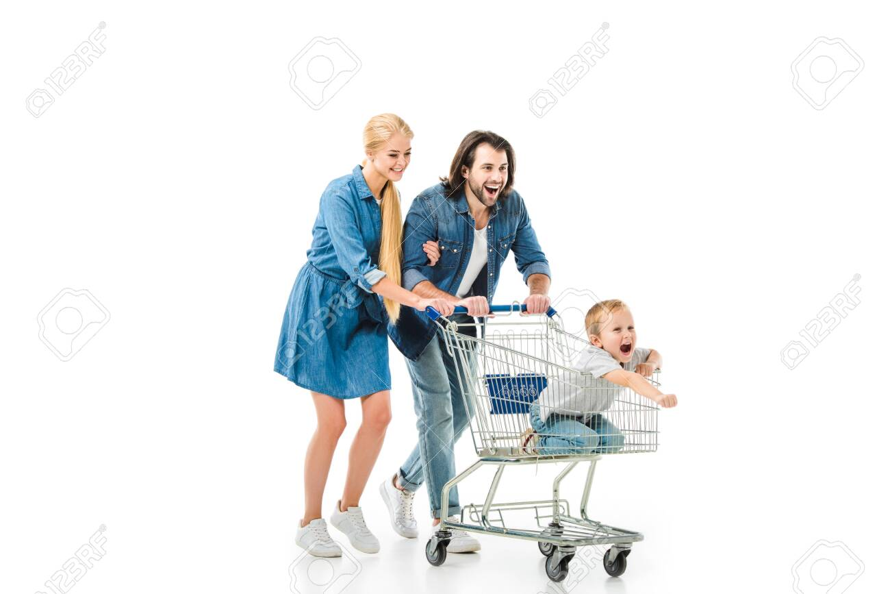 Happy parents riding their son on the shopping cart and having fun isolated of white - 112164047