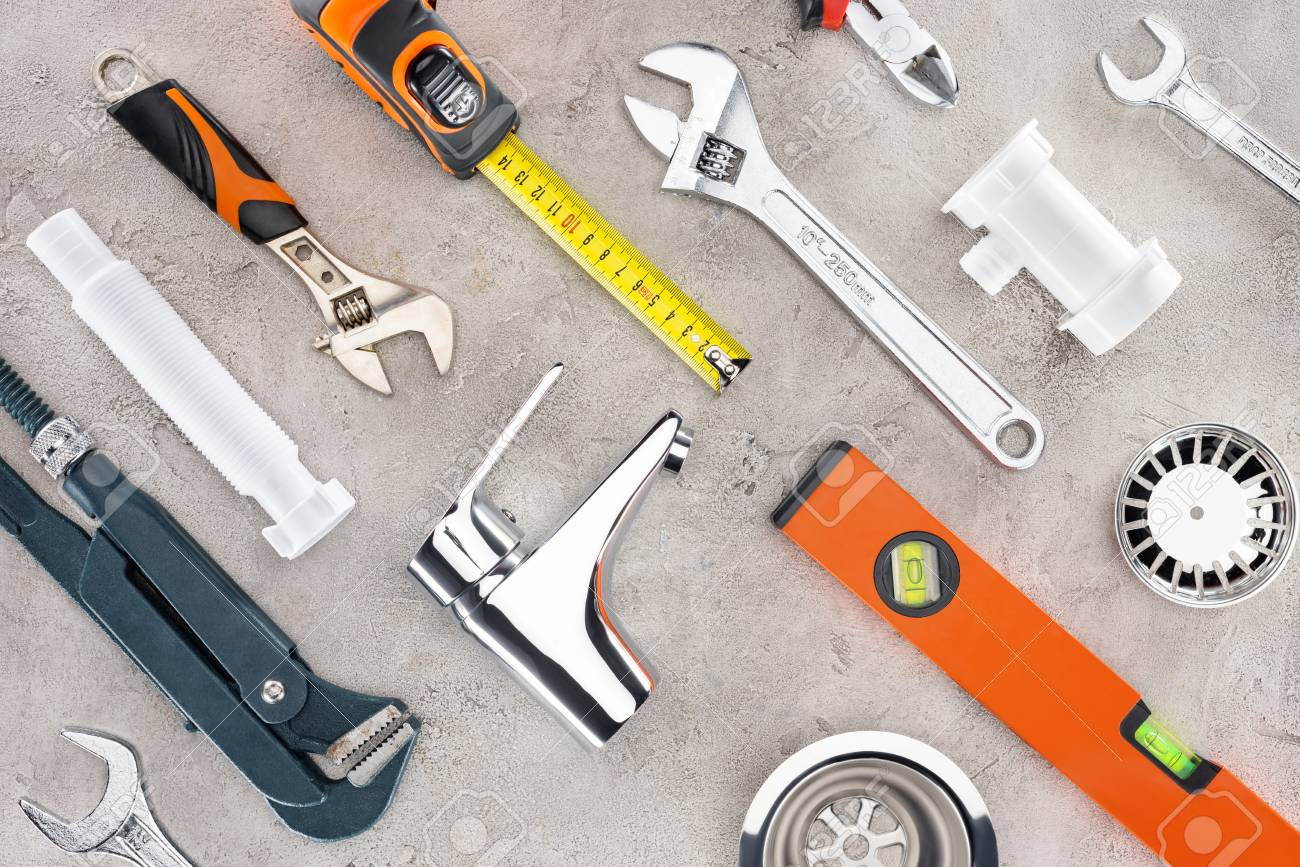 flat lay with various plumbing tools on concrete surface - 112355622