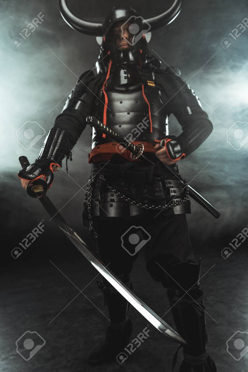 Samurai In Traditional Armor With Swords On Dark Background With Stock Photo Picture And Royalty Free Image Image 112769792