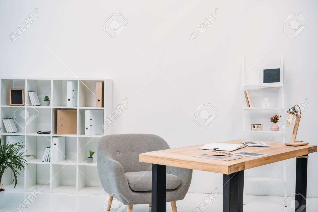 modern office interior with papers and digital tablet on table - 114250652