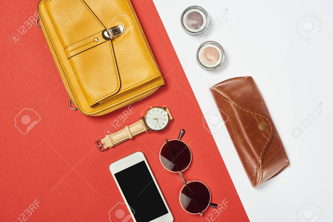 Top view of bag, sunglasses, eyeshadow, smartphone, watch and case - 116388759