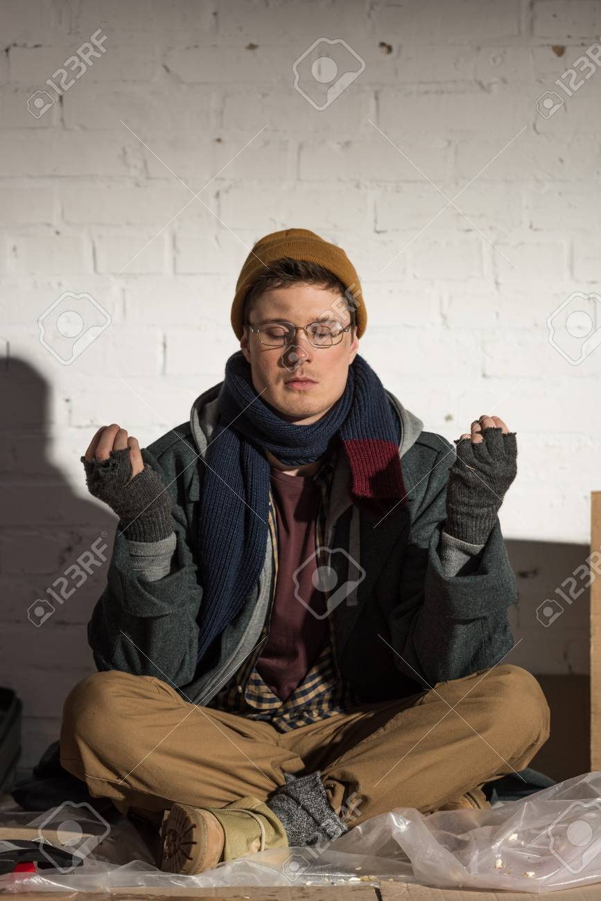 Homeless Man Sitting In Lotus Pose With Closed Eyes Near White ...