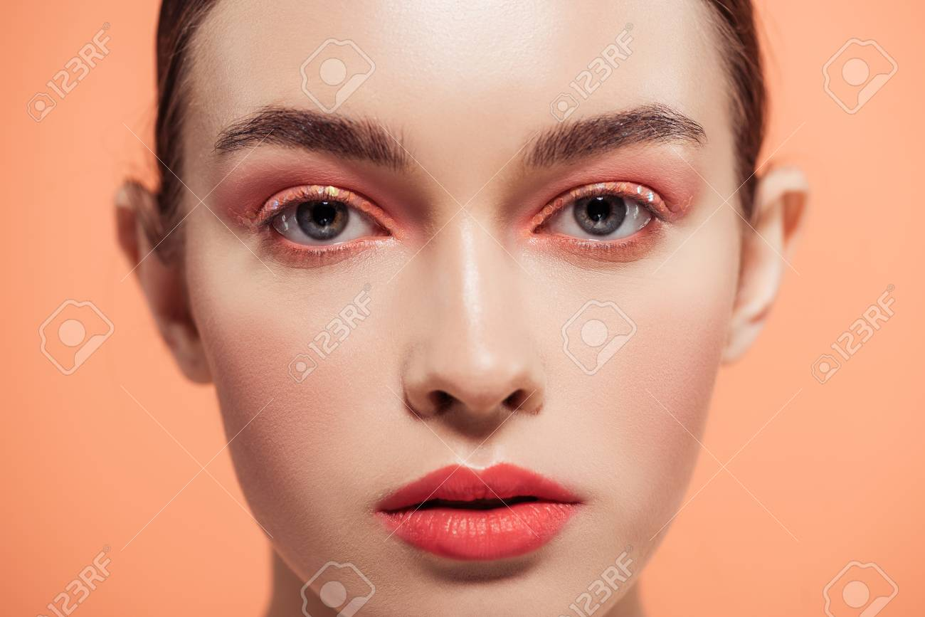 beautiful stylish young woman looking at camera and posing isolated on coral - 118997347