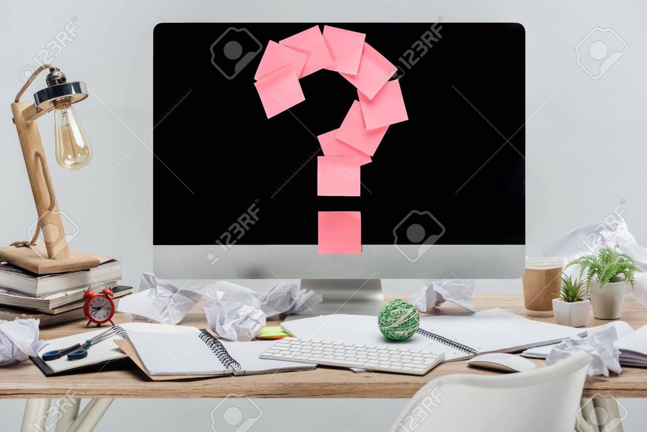 modern workplace with pink question mark made of sticky notes