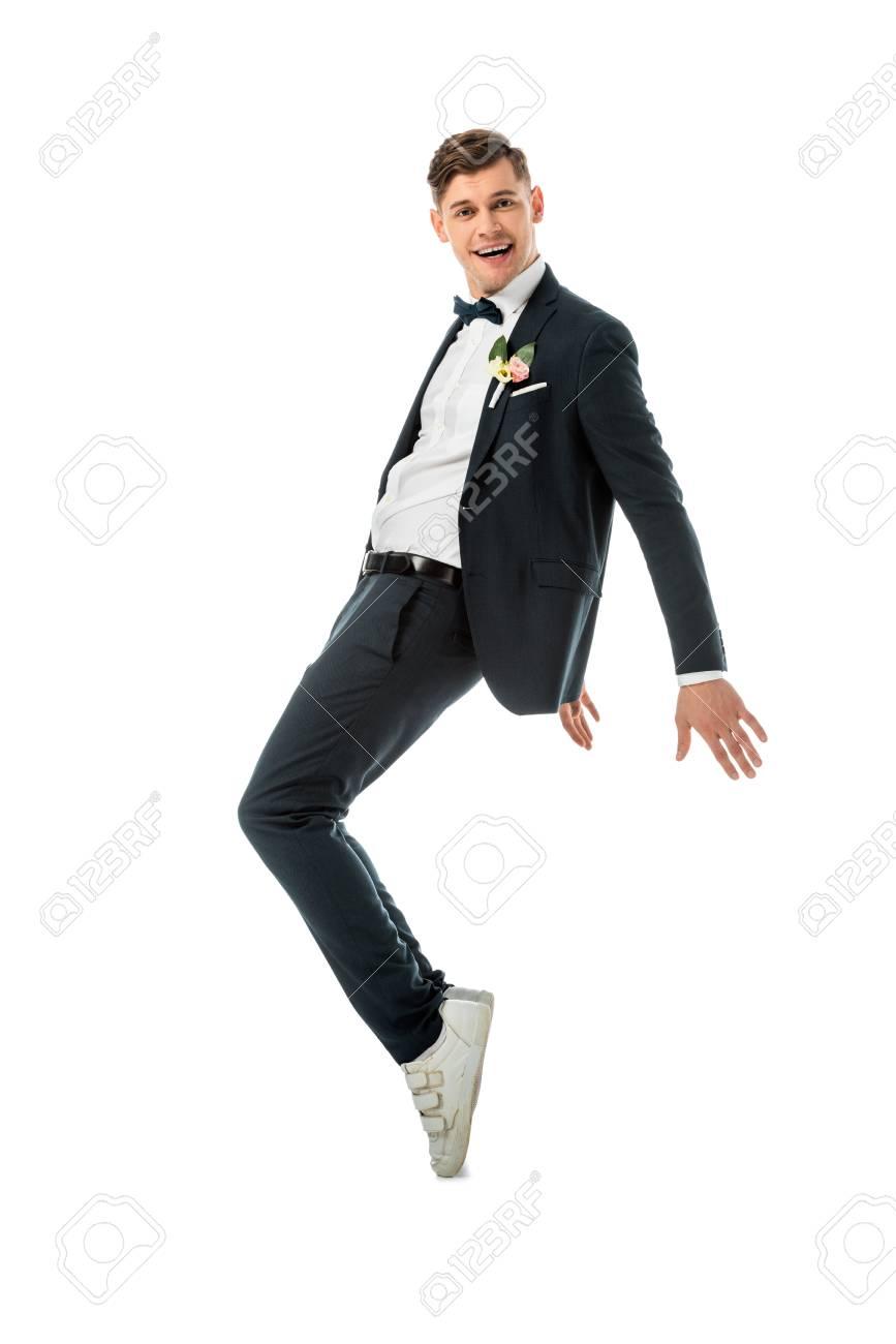 Cheerful Groom Dancing In Black Suit