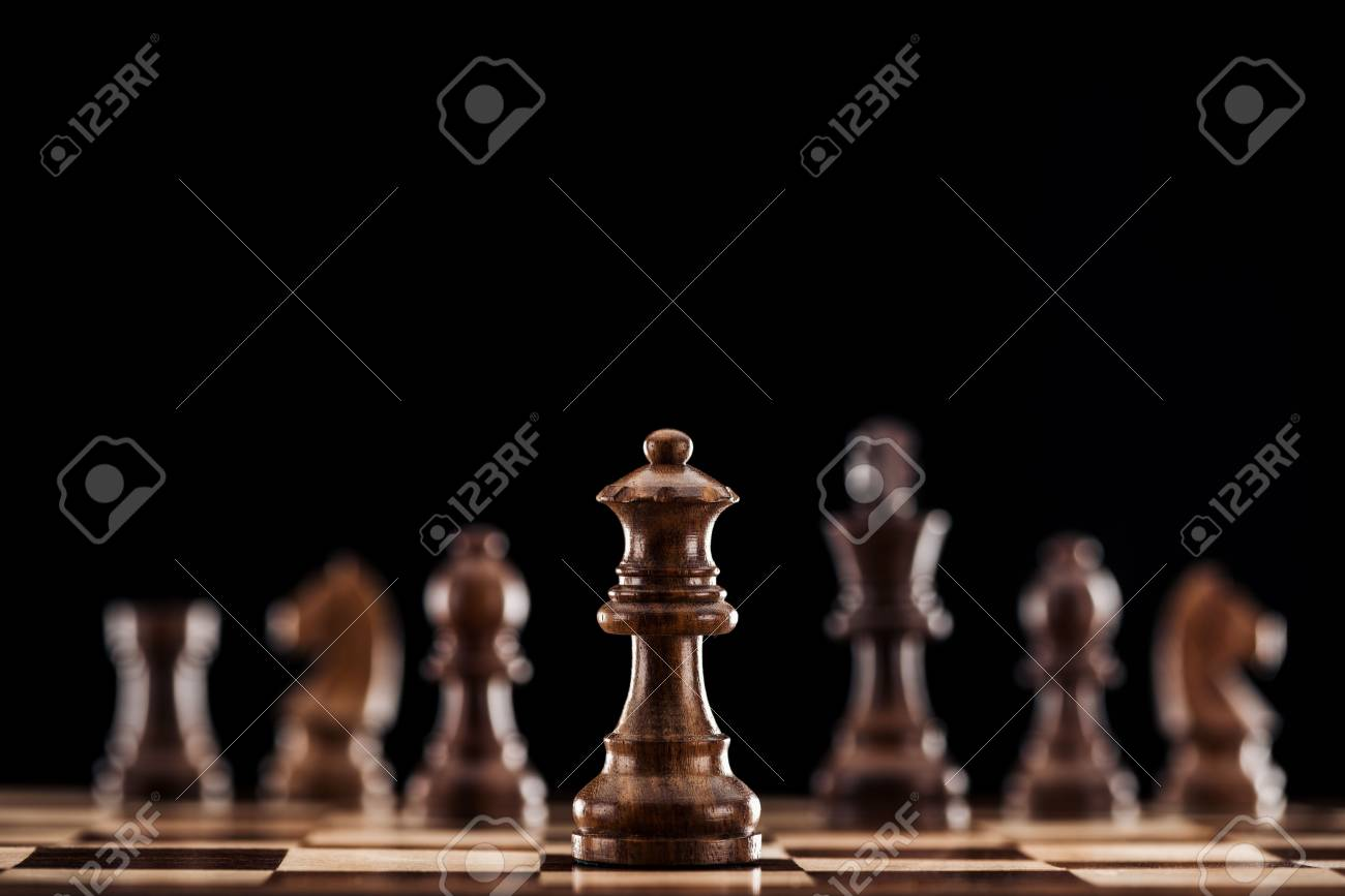 selective focus of brown wooden queen on chessboard isolated on black - 120075516