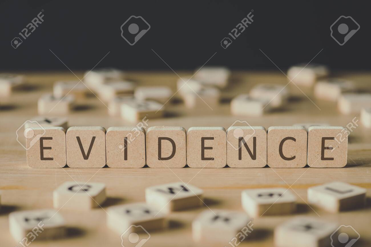 selective focus of word evidence made of cubes surrounded by blocks with letters on wooden surface isolated on black - 125402248