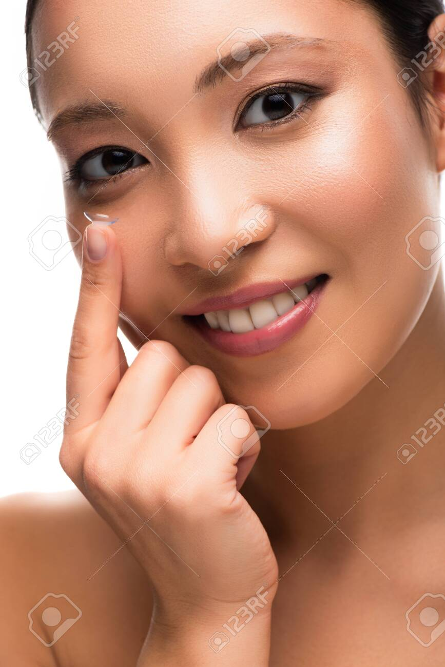 Happy attractive Asian girl with contact lens, isolated on white background - 126606894