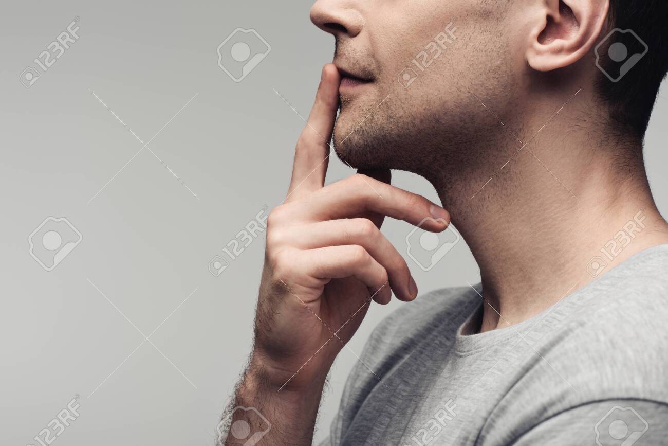 partial view of dumb man showing silence sign isolated on grey, human emotion and expression concept - 128147265