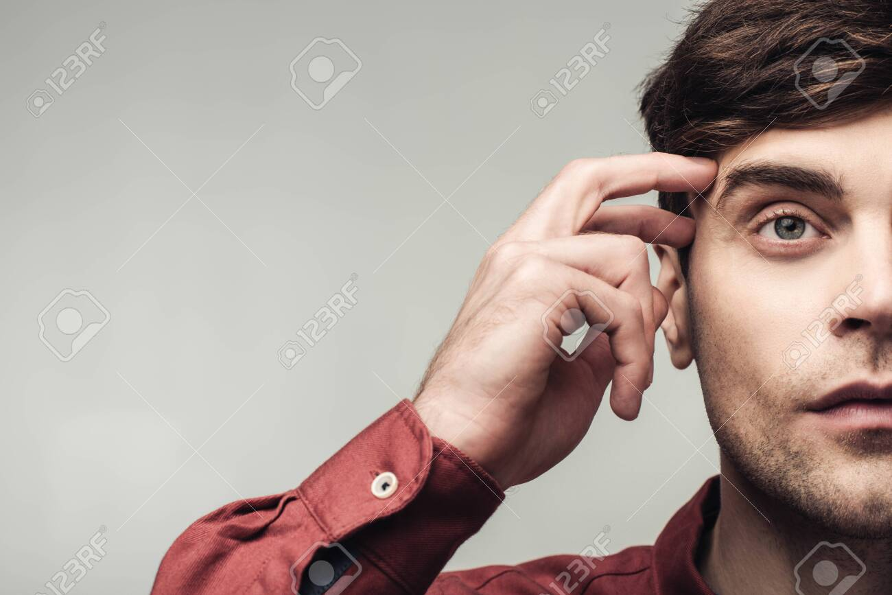 cropped shot of pensive man looking away and touching head isolated on grey, human emotion and expression concept - 128156560