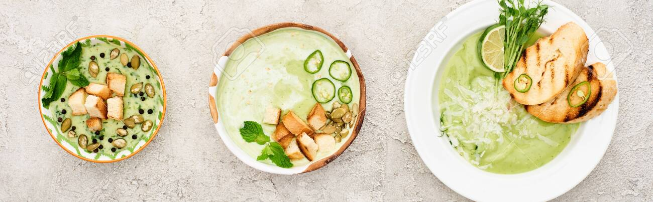 flat lay with delicious creamy green soup served with croutons, panoramic shot - 130442502
